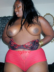 Naked Thick black woman in a huge red..