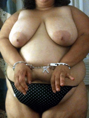Fat ebony woman in police handcuffs