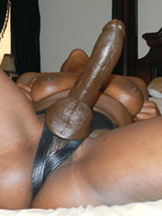 Black woman uses strap-on in their..