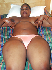 Black slut topless on the bed, I love..