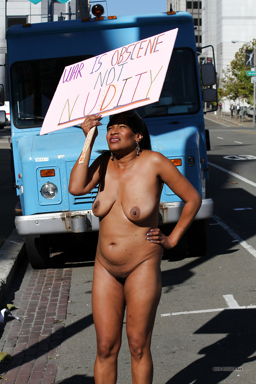 naked black mature walking in the street and protests. photo #2